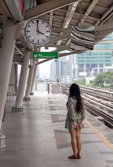 Young woman waiting on the platform