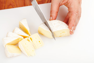 cutting brie cheese