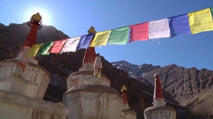 Low angle Buddhist prayer flags and stupas