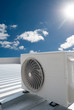 White air conditioning unit on a roof - 77942774