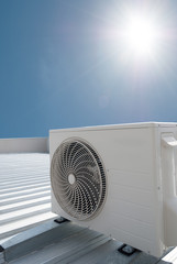 White air conditioning unit on a roof
