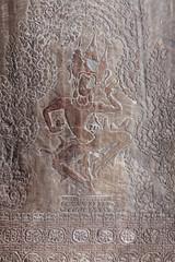 Carving of dancing Shiva on the wall of Angkor Wat