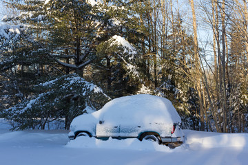 SUV covered with snow