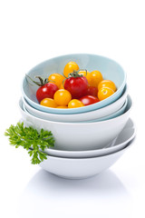 clean bowls, assorted cherry tomatoes and parsley, isolated
