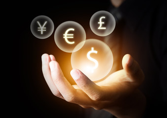 International currencies on businessman's hand
