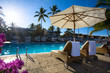 Leinwanddruck Bild - art Deckchairs in tropical resort hotel pool