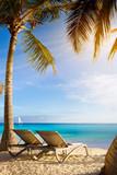 art Deckchairs in tropical beach