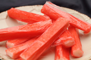 Fresh crab stick on the clean plate.