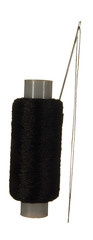 Spool of black thread and needle isolated on white background.