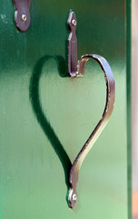 reflection of the door handle in the shape of heart