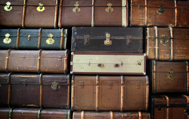 large stack of antique suitcases