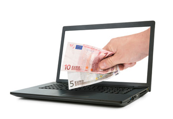 Laptop and hand giving Euro banknotes