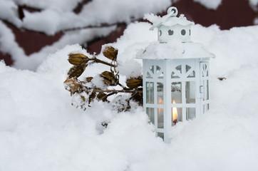 Burning lantern winter day