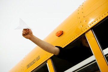 School Bus: Boy Holds Paper Airplane Out Window
