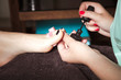applying nail polish - 77952386