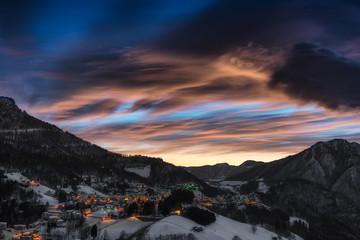 Alpine village winter after sunset
