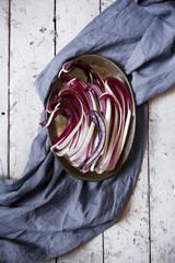 overhead shot of radicchio treviso quality on tray on table