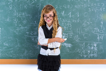 Nerd pupil blond girl in green board schoolgirl