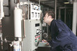 maintenance engineer checking technical data of heating system e - 77954777