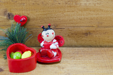 Heart shaped ceramic box and a ladybug ornament