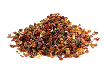 A mixture of dried vegetables and spices on a white background