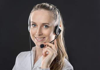 beautiful girl in headphones with a microphone
