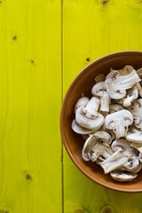 Whole Champignons in a Bowl on Wooden Boards