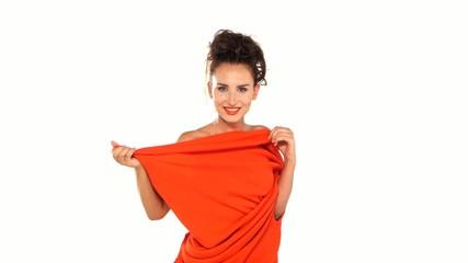 Red dress-changeling wears brunette attractive woman on white