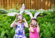 Girls Wearing Bunny Ears and Silly Egg Eyes - Close Up - 77957957