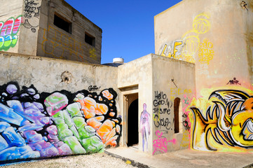 Abandoned building covered with graffiti near Jerusalem.