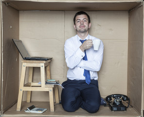businessman during a break for coffee in his office