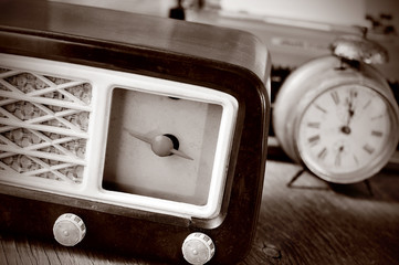 antique radio, alarm clock and typewriter, in sepia toning