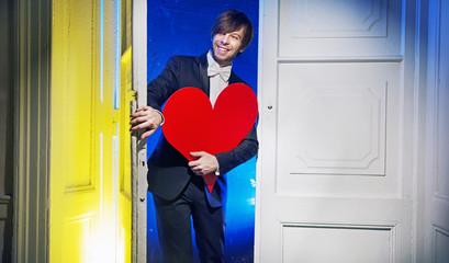 Joyful man visiting girlfriend with valentine