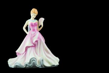 Bone China Figurine Wearing a Pink Dress and Holding a Fan