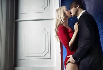 Handsome man seducing his pretty lady
