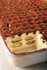 Dessert tiramisu cake on wooden background