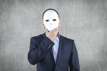Businessman hidden behind the mask