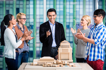 Team of architects in successful presentation