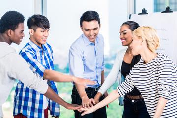 Tech entrepreneurs with team spirit and motivation