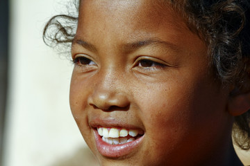 Smiling poor african girl, Madagascar