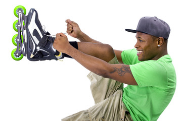 young adult black man posing with rollerblade skates