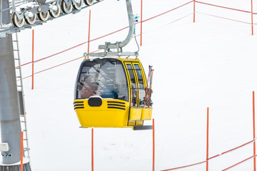 yellow cable car on Alpine ski slope