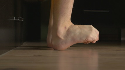 4k UHD - Young male feet getting out of bed