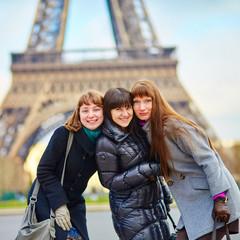 Three girls near the Eiffel tower