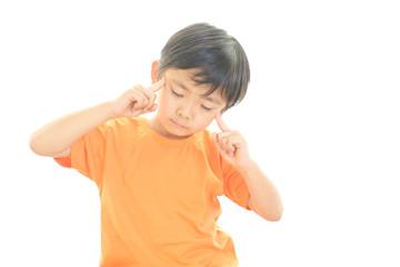 頭痛を訴える男の子