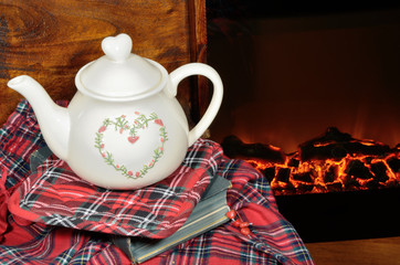 A teapot by the fireplace