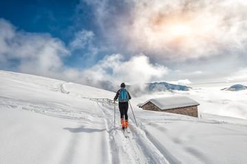 A girl makes ski mountaineering