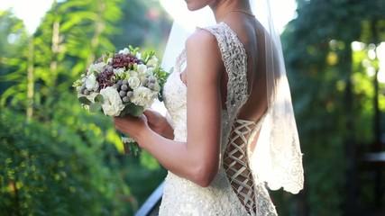 Bride holding wedding bouquet on a sunny wedding day
