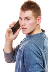 Young man talking on mobile cell phone