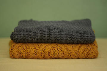 Ocher and grey winter sweaters, selective focus.